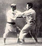 Dr. Kano (Left) and a student (Right) practicing 'Randori', or Free-Fighting