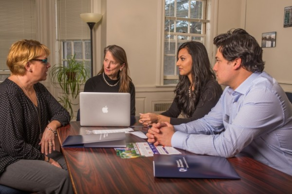 Career and Professional Services associate vice provost Trudy Van Zee, second from left, meets with colleagues Raina Sarvaiya, Raul Bernal and Kimberly Clark in Hood House. (Photo: Valerie Lester, Communications and Public Affairs)