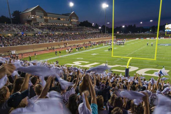 fans cheering during a football game at UNH's Wildcat Stadium