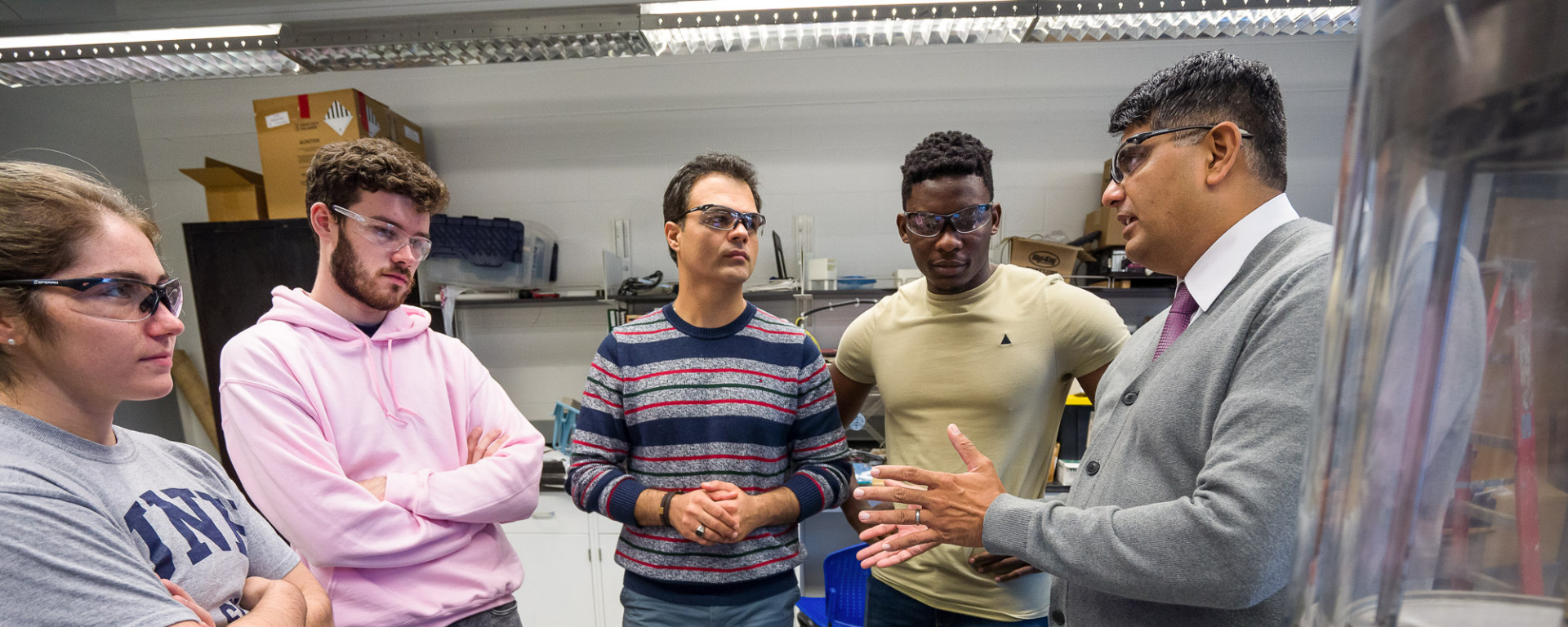 David Eshan with students in lab
