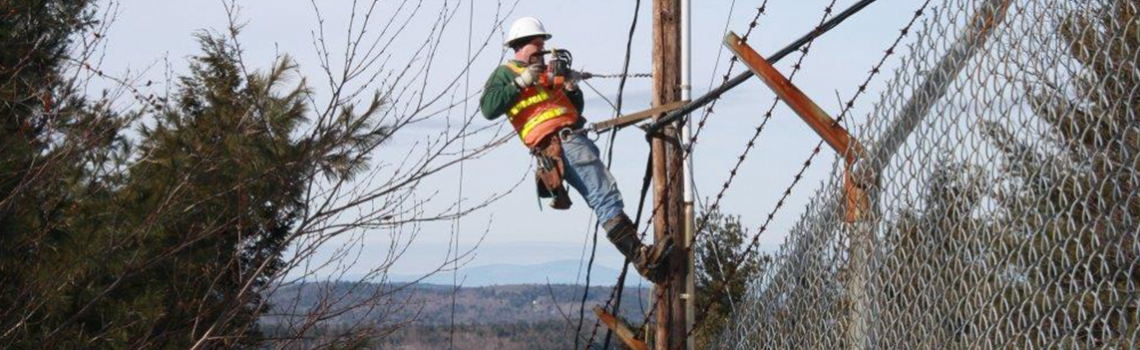 PIcture of man working on telephone pole