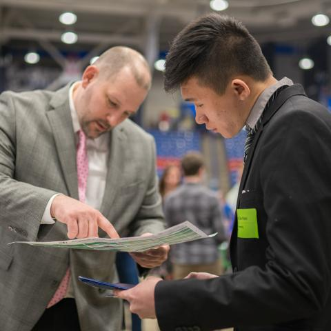 Student and employer at UNH Career Fair