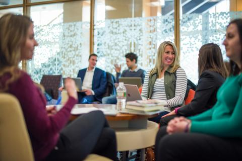 Image of a alumni mentors and students networking together at a Wildcat Connections event