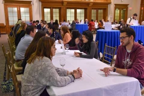 Image of UNH students and Alumni practicing networking skills at No Stress Networking Night