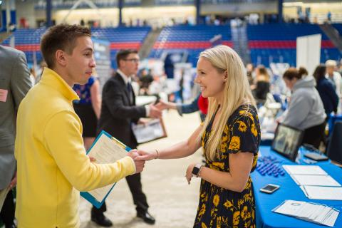 Image of Students and Employers meeting at the UNH Career and Internship Fair at the Whittemore Center