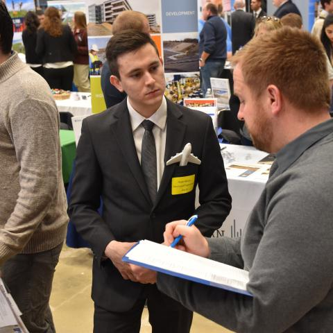 Image of students at the Career Fair at UNH meeting with attending employers