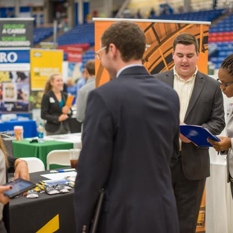 Image of students at UNH networking at the Career Fair