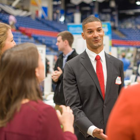 UNH student talking with an employer at UNH's Career Fair