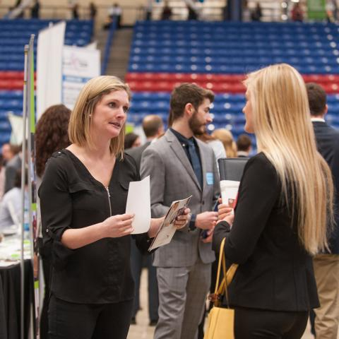 Image of employers and students at the Career and Internship Fair at UNH's Whittemore Center