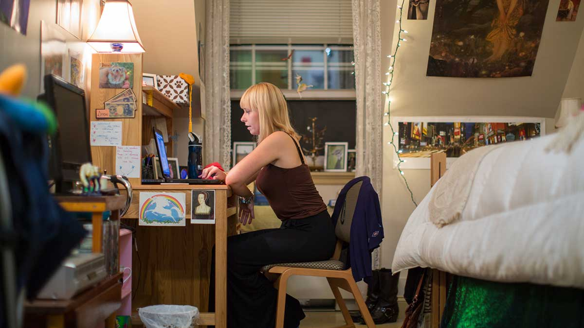 UNH female student in a dorm