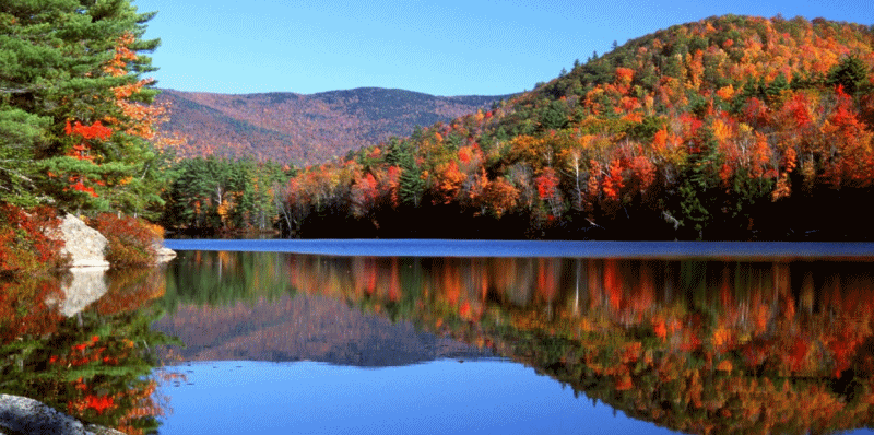Daytime photo of New Hampshire lakes with fall foliage