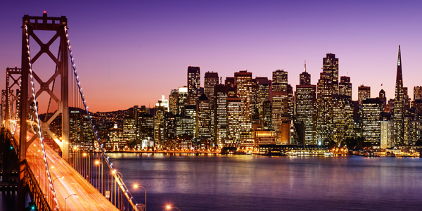 Night time photo of San Francisco skyline.