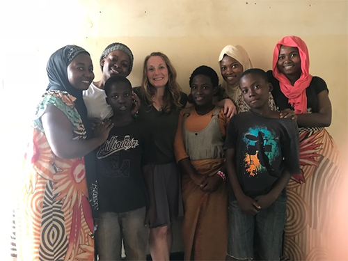 Dr. Amy VanCamp (center) during a home visit with a refugee family