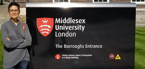 Professor Negron-Gonzales next to Middlesex University sign
