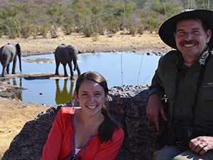 Alicia Walsh, Biomedical Science-Pre-Vet major and Drew Conroy, professor of Applied Animal Science  at the Halali Waterhole in Etosha National Park, Namibia