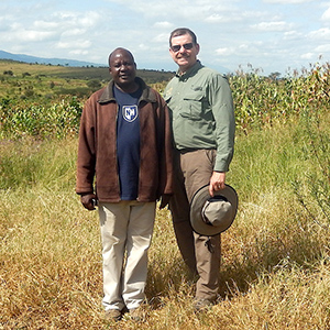 Drew Conroy and Lobulu Sakita in Monduli, Tanzania – Note the new UNH Logo…