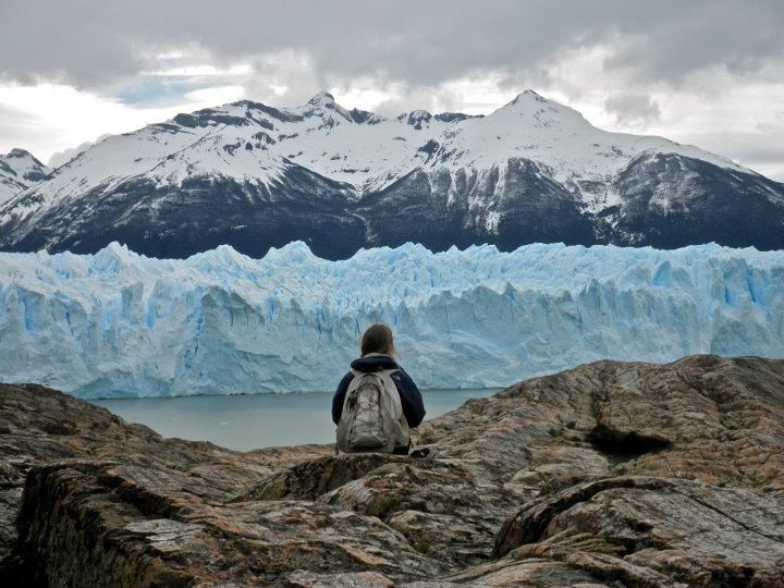 Photo of student in front of glacier