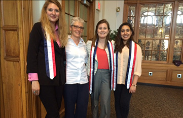 Prof. Claire Malarte-Feldman (second from l.) with seniors at 2016 IA luncheon