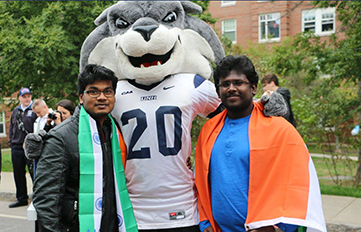 international students with UNH mascot Gnarlz