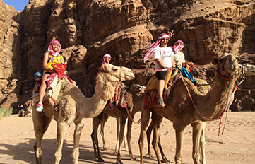 UNH students riding camels in Egypt
