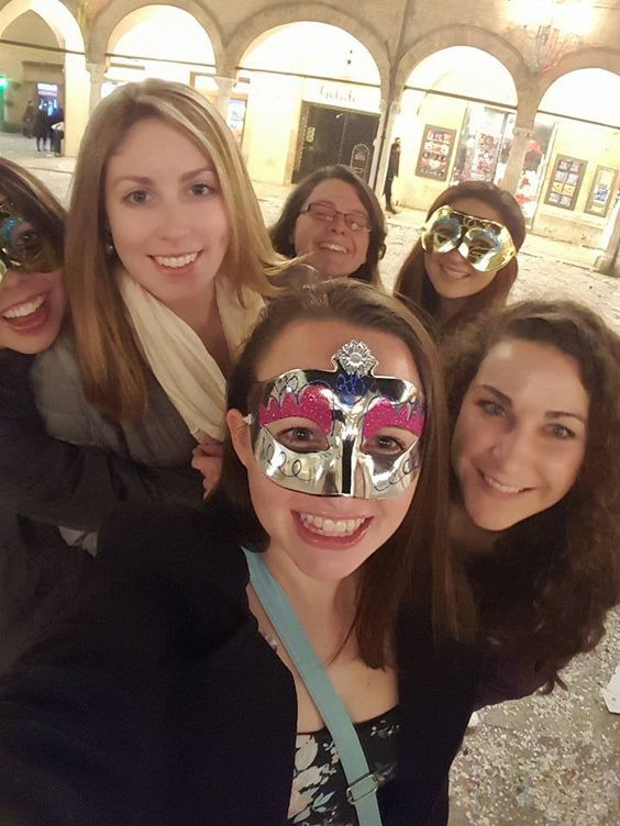 Amber Skerry and her friends at a masquerade ball