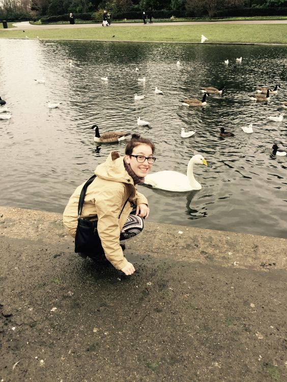 Angela Lawrence-Hurt feeding ducks at a pond in London