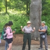 UNH students listening to a forest ranger n Bhutan