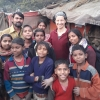 Yusi Terrell (wearing headband) with Indian Slum family