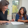 Amada Guapisaca (r.) chats with a career counselor (l.)