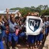 photo of young students in Africa showing UNH banner