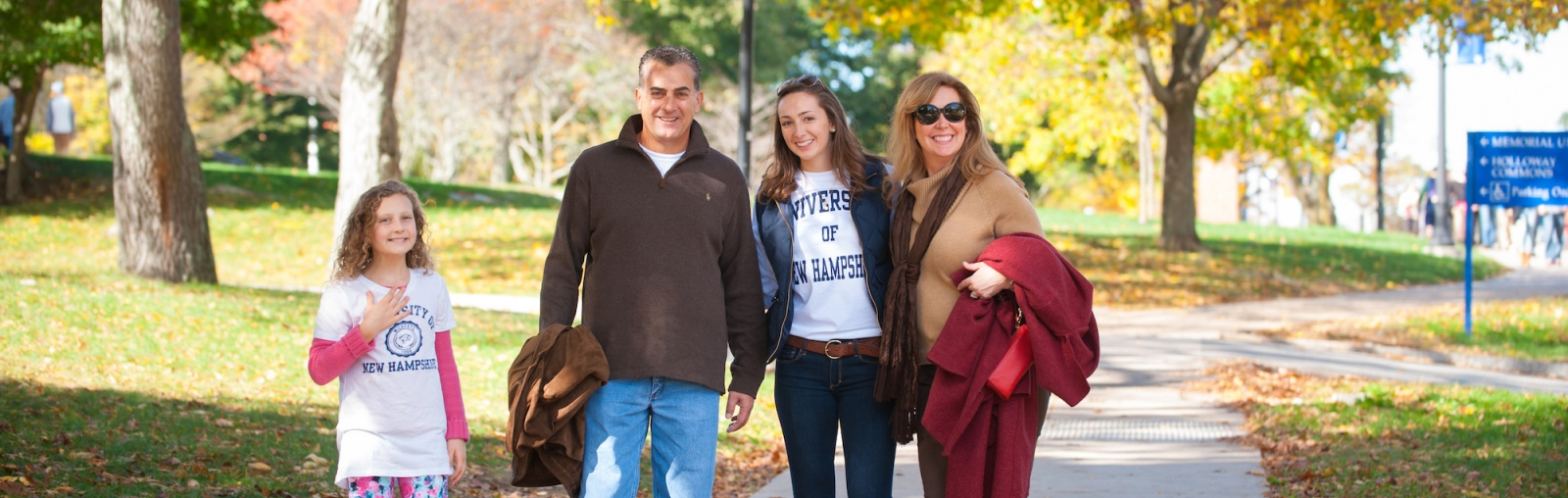 UNH student (second from right) with her family on Durham campus Main St.
