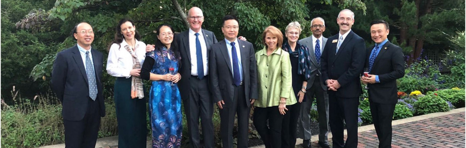 UNH President Dean and Chengdu University President Wang (3rd and 4th from left) with other university staff