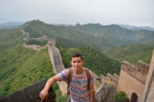Photo of student in front of Great Wall of China