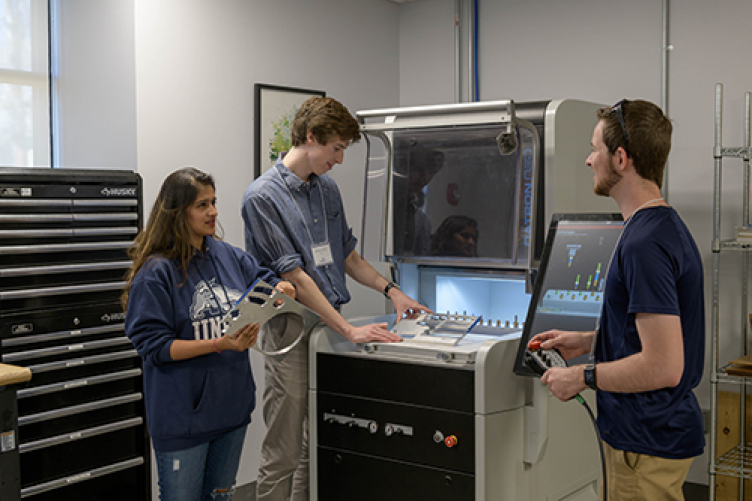 Sryiaa Shah '18 (l) learns how to use the CNC Mill in the ECenter Makerspace
