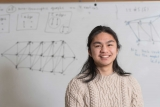 photo of Eden Suoth '18 in front of whiteboard with mathematical calculations