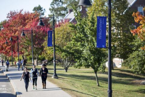 students on unh campus main st banners