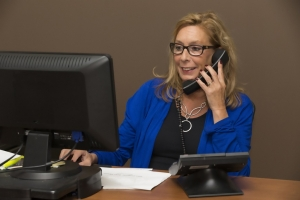 Woman at a desk on the phone