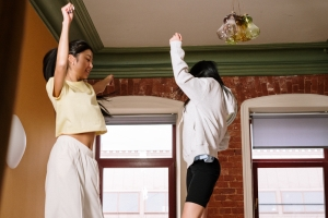 Two people dancing at home