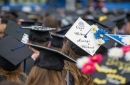 UNH students' graduation caps during the commencement ceremony