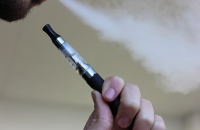 Person vaping an electronic cigarette