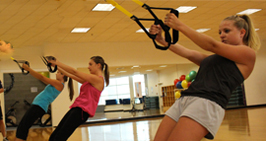 photo of students in a group fitness class