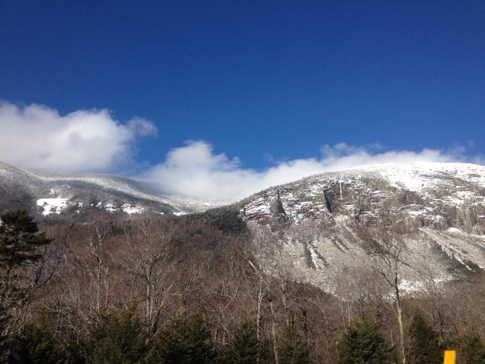 picture of mountain peak with blue sky and clouds