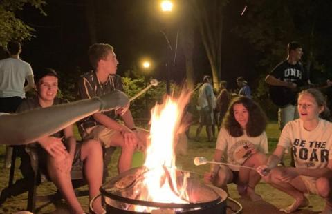 students roasting marshmallows