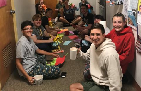 students sitting in hallway of dorm