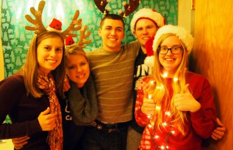 students wearing santa hats and antlers