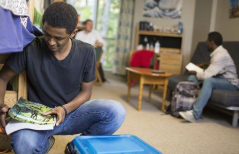 Adams Tower West students studying in dorm room