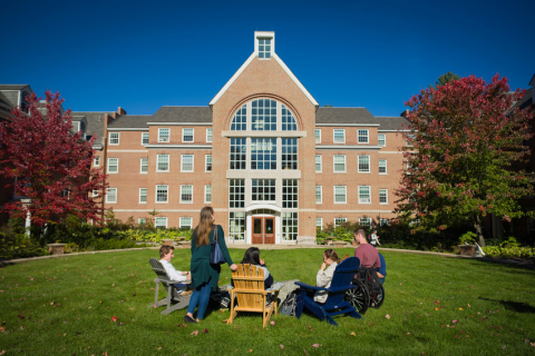 students sitting on the front lawn of Congreve Hall