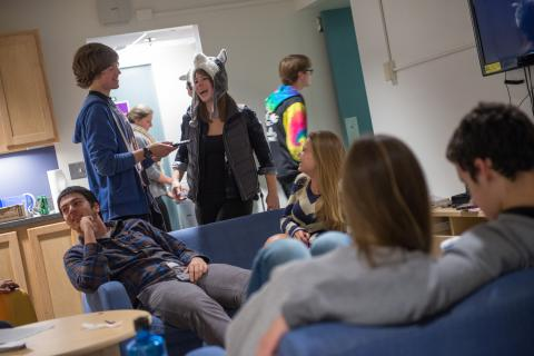 Students socializing in a housing common area
