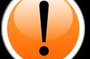 Black exclamation point on orange background indicating caution