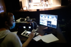 Photo of a student running video equipment for a theatrical production